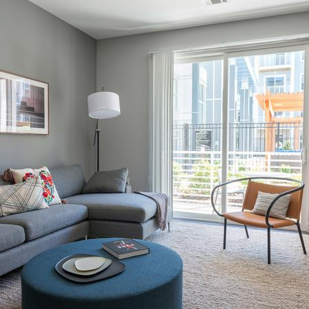 Bright and Spacious Living Room with Patio | Modera Medford