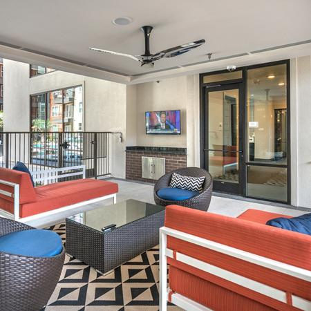 Outdoor Courtyard with Seating and Televisions| Modera Near the Galleria