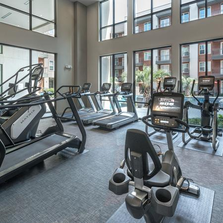 Treadmills, Ellipticals and Stair Machines in our Fitness Center | Modera Near the Galleria