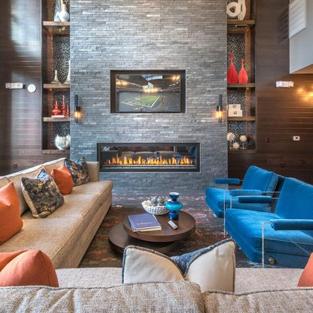 Posh Clubhouse Lounge with Fireplace and Television | Modera Near the Galleria