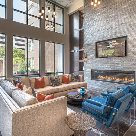 Indoor Resident Clubhouse with Fireplace and Television | Modera Near the Galleria